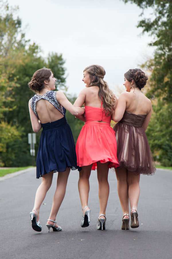 three girls wearing altered prom dresses